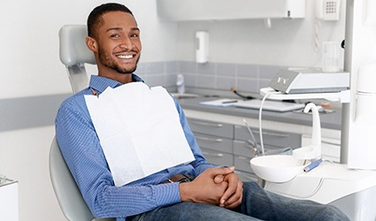 A young, male patient waiting to see the dentist for a regular checkup
