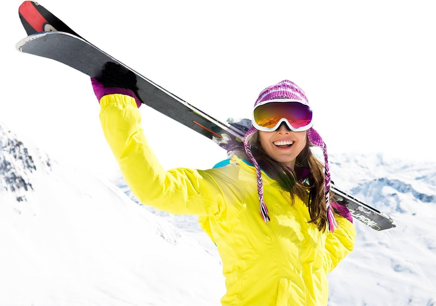 Smiling woman holding skis