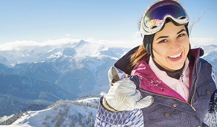 Woman at the top of a ski slope