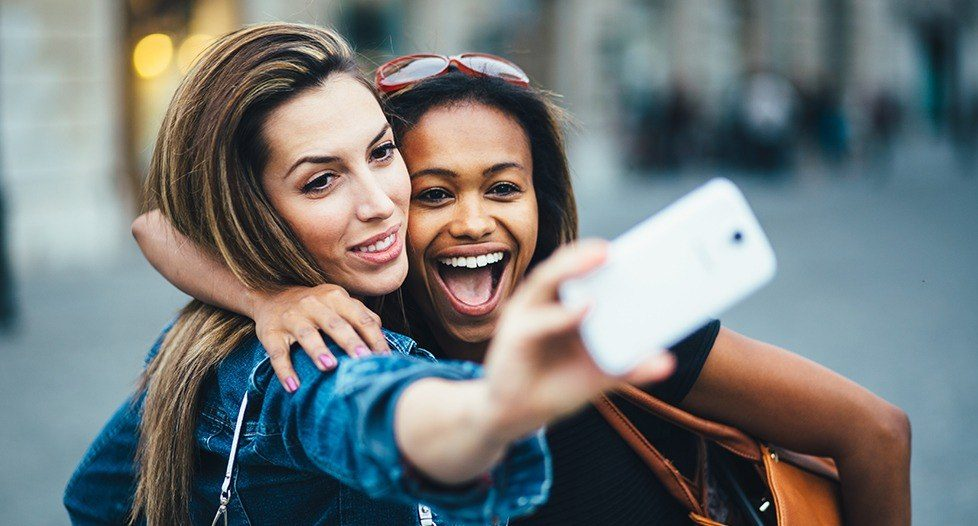 Two young woman taking a selfie