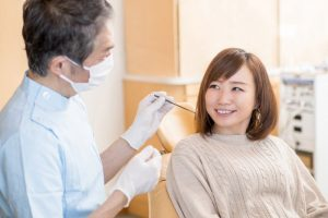 cosmetic dentist in Park City explaining the difference between veneers and dental bonding to a patient